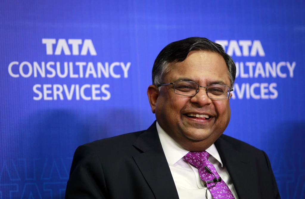 Chandrasekaran, chief executive officer of TCS, laughs while interacting with reporters during a news conference in Mumbai