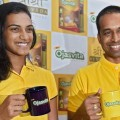 Mumbai: Badminton player PV Sindhu along with her coach Pullela Gopichand during the launch of 'Ojasvita Malt' a product by Sri Sri Ayurveda, in Mumbai on Friday. PTI Photo by Shashank Parade  (PTI10_14_2016_000094B)