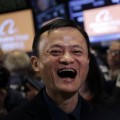 "Jack Ma, founder of Alibaba, smiles during the company's IPO at the New York Stock Exchange, Friday, Sept. 19, 2014 in New York. The stock is expected to start trading Friday under the ticker ""BABA."" The IPO values Alibaba at $167.62 billion, larger than the current market value of Amazon, Cisco, and eBay. (AP Photo/Mark Lennihan)"
